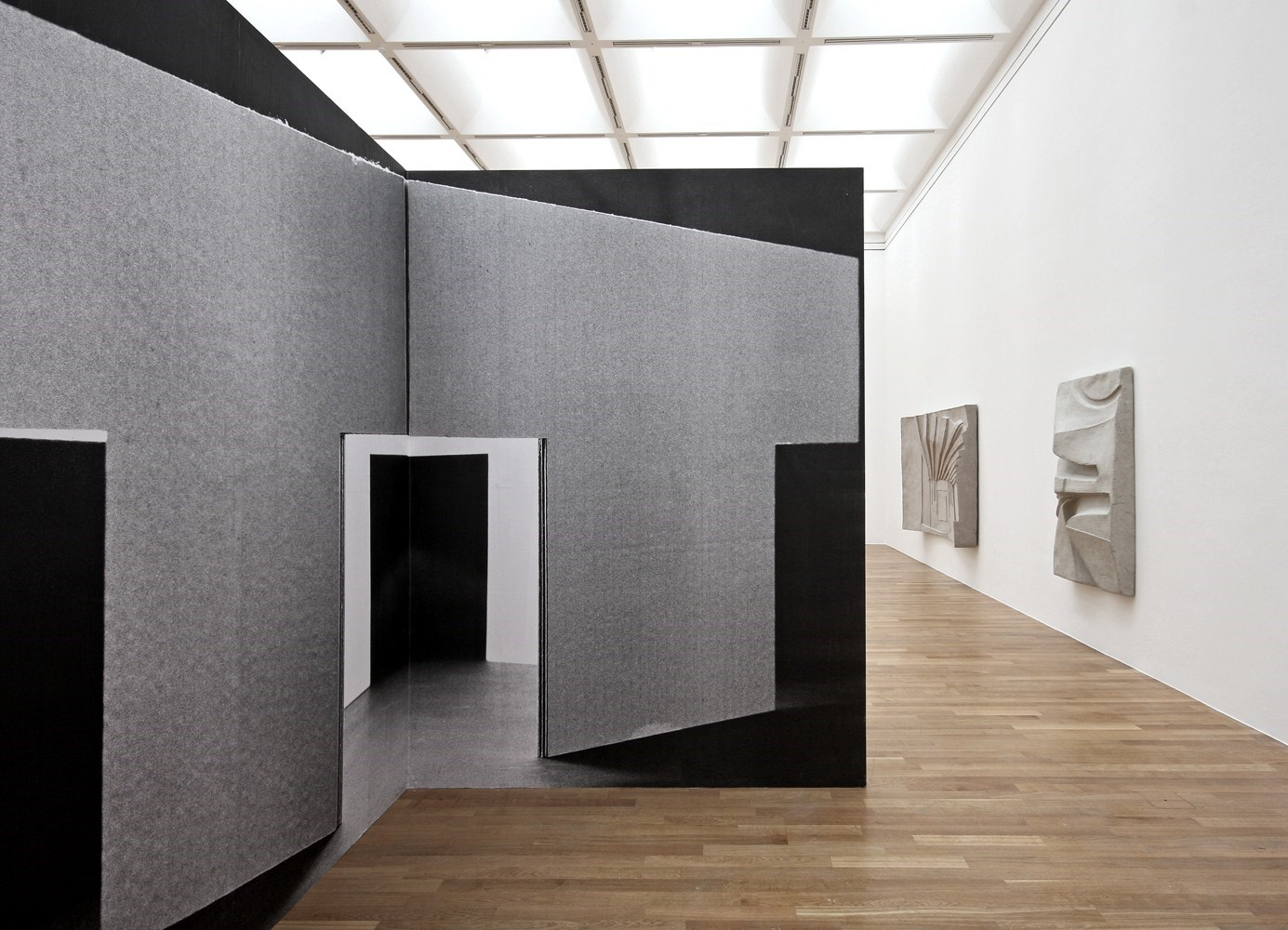 Untitled, 285cm x 420cm x 420cm, black & white prints and wood, 2010 <br />Installation view Kunstmuseum Bonn