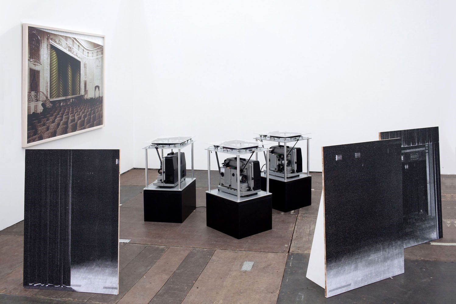 Leere Bühne, 3 x 110 cm x 70 cm, black & white prints, wood, 2009<br />Installation view Sassa Trülzsch, Frieze Art Fair, Frame, London