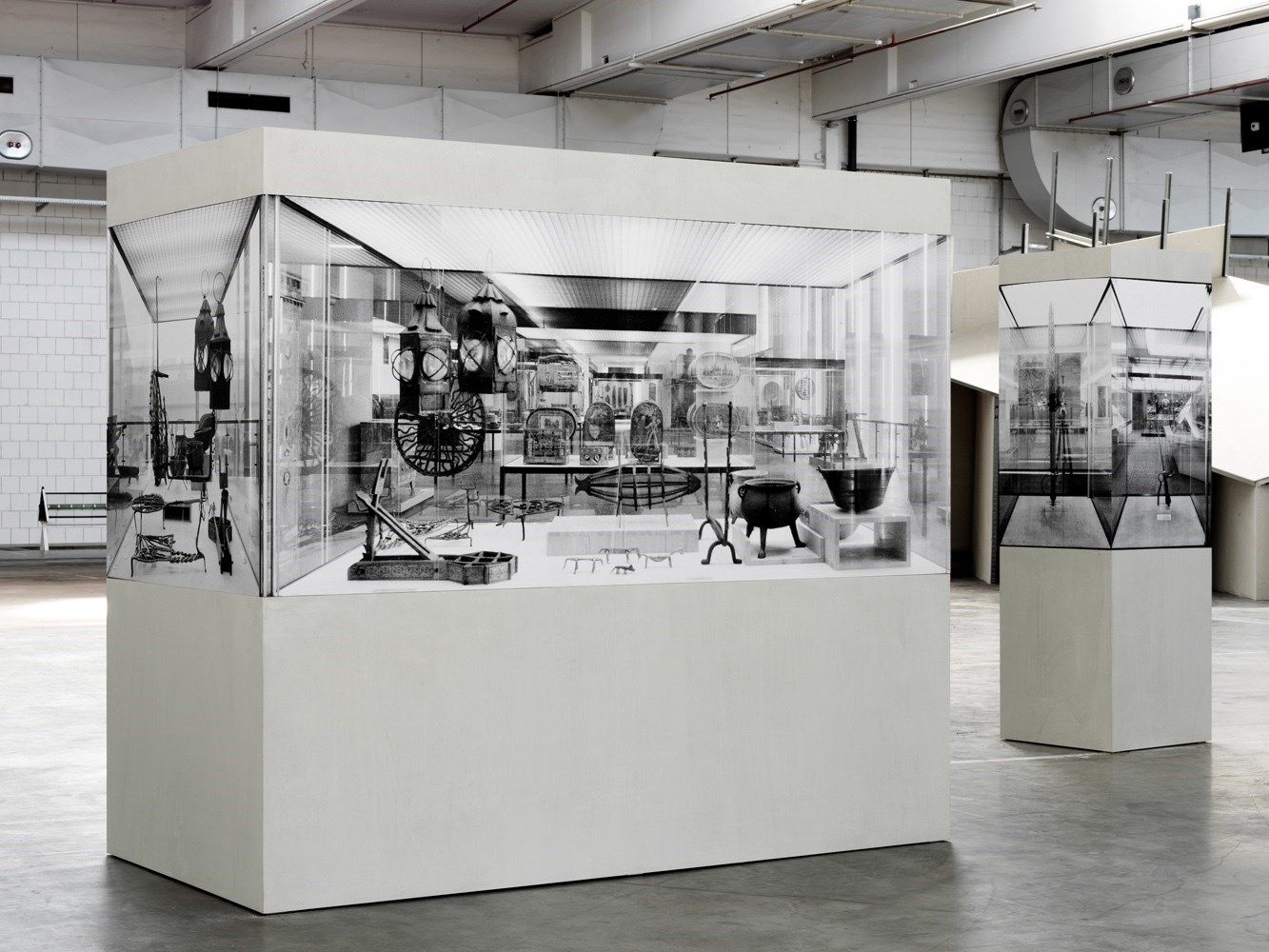 Vitrine (bäuerlicher Hausrath), 180 cm x 111 cm x 222 cm; <br />Vitrine (Schwert), 195 cm x 60 cm x 60 cm, black & white prints and wood, 2011<br />Installation view AEG Nürnberg
