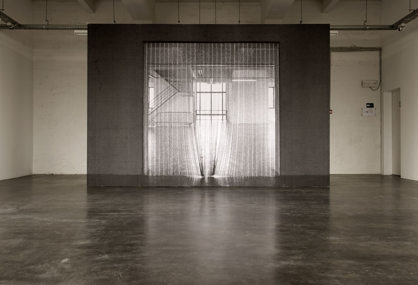 Untitled, 285cm x 425cm, black and white prints on wood, 2010<br />Installation view Wiels, Brussels